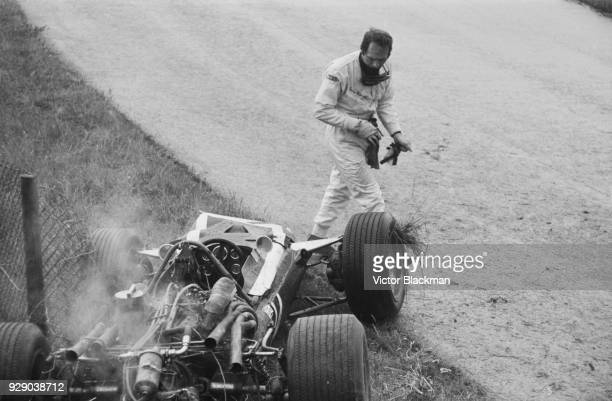 ItalianBelgian racing driver Lucien Bianchi leaving his vehicle #14 CooperBRM T86B after having an accident after 9 laps at the Dutch Grand Prix...