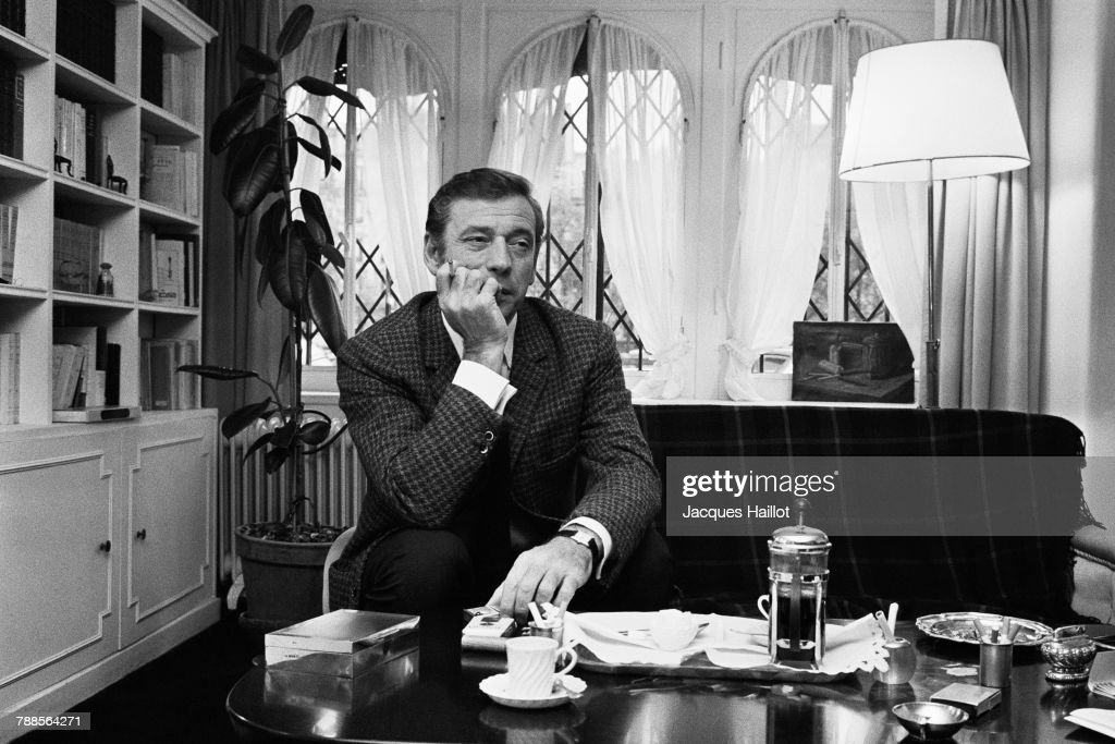 Italian-born actor and singer Yves Montand in his apartment in Paris.