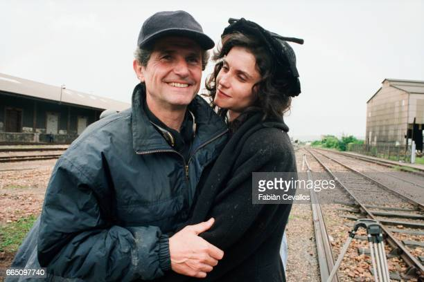 Italianborn actress Alessandra Martines embraces her husband French director Claude Lelouch on the set of his film Les Miserables based on Victor...