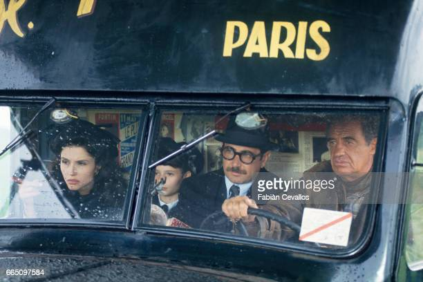 Italianborn actress Alessandra Martines Salome Lelouch Tunisianborn actor Michel Boujenah and French actor JeanPaul Belmondo on the set of the film...