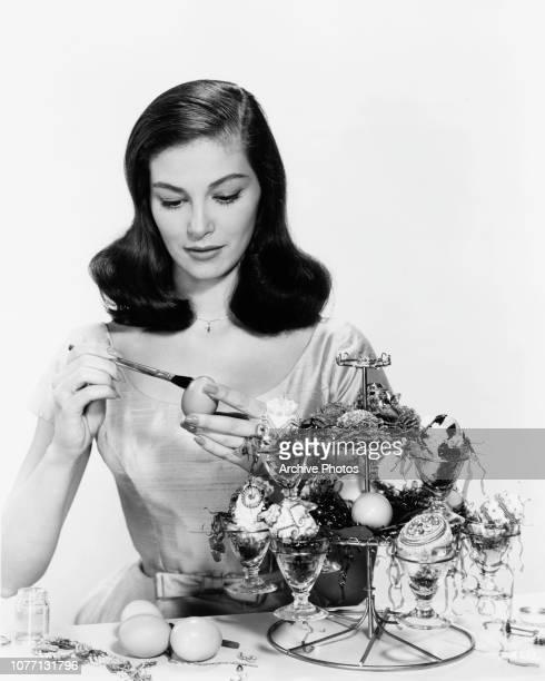 Italianborn actress Pier Angeli decorates Easter eggs 1958