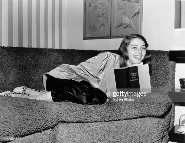 Italianborn actress Pier Angeli reads a copy of the book 'National Velvet' by Enid Bagnold circa 1950