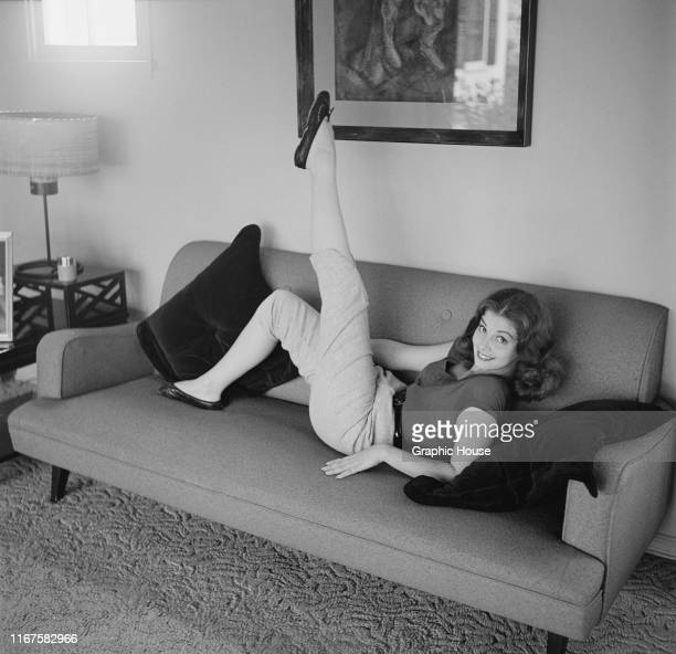 Italianborn actress Pier Angeli relaxes on the sofa USA circa 1955