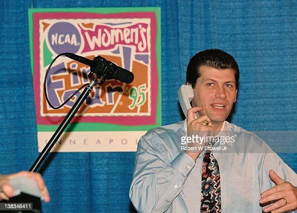 Italianborn American basketball coach Geno Auriemma of the University of Connecticut accepts a call from the US President following his teams victory...