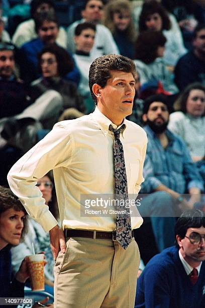 Italianborn American basketball coach Geno Auriemma of the University of Connecticut watches the action during a game in Gampel Pavilion Storrs...