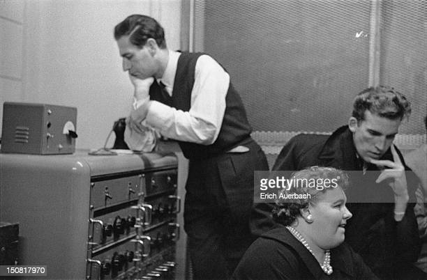 Italianborn American composer Gian Carlo Menotti conductor Thomas Schippers and soprano Eileen Farrell listen to a recording of an aria from...