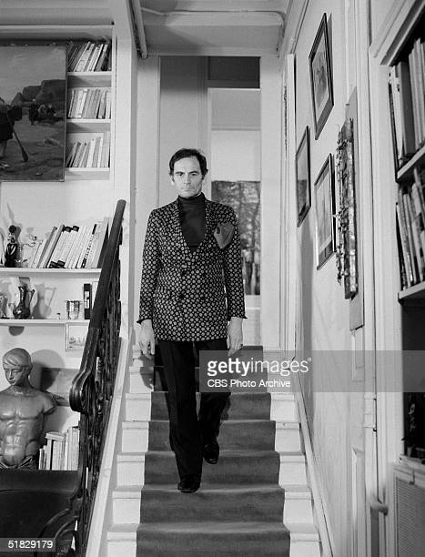 Italianborn fashion designer Pierre Cardin descends a staircase during the CBS special 'The Paris Collections Fall Fashion Preview' June 26 1968