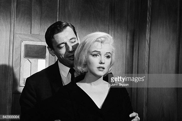 Italianborn French actor and singer Yves Montand and American actress singer and model Marilyn Monroe on the set of Let's Make Love directed by...