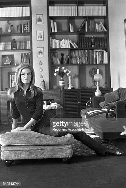 Italianborn French actress and singer Dalida posing in the living room of her house Paris 1970