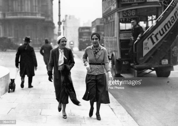 Italianborn French fashion designer Elsa Schiaparelli arrives in London wearing her latest fashion design the trousered skirt or culottes