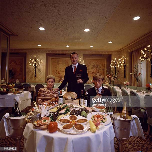Italianborn restaurateur Sirio Maccioni with his wife Egidiana and one of their sons at Le Cirque his establishment in New York June 1984