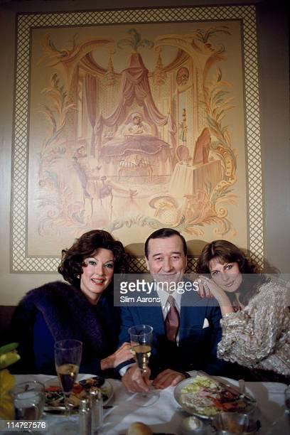 Italianborn restaurateur Sirio Maccioni with socialites Anna Moffo Sarnoff and Christina Delorean at Le Cirque his establishment in New York April...