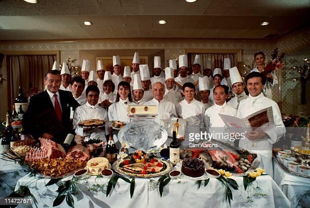 Italianborn restaurateur Sirio Maccioni with staff at Le Cirque his establishment in New York 1990 On the far right is Executive Chef Daniel Boulud