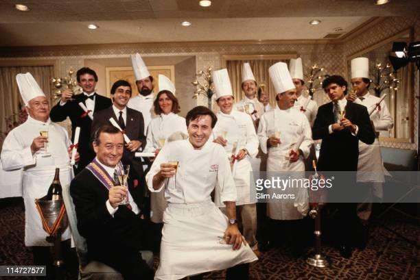 Italianborn restaurateur Sirio Maccioni with staff at Le Cirque his establishment in New York circa 1990 Executive Chef Daniel Boulud is seated centre