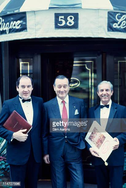Italianborn restaurateur Sirio Maccioni with staff at Le Cirque his establishment in New York 1990