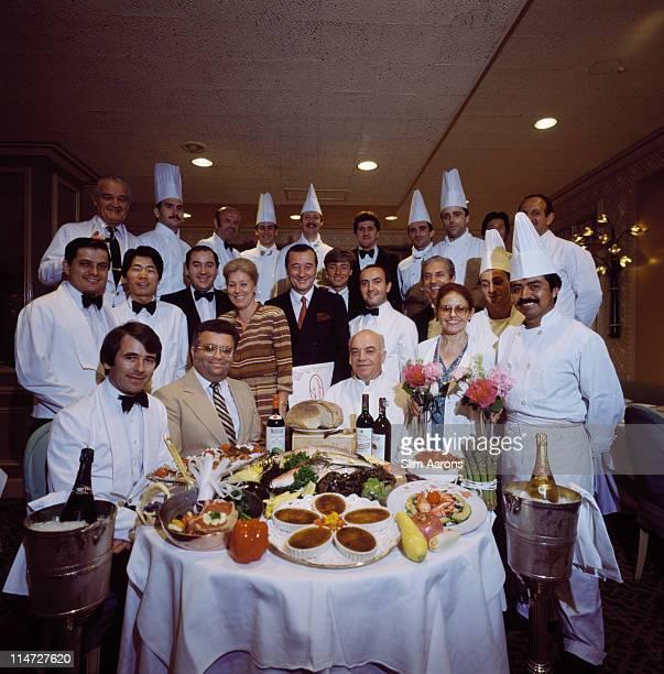 Italianborn restaurateur Sirio Maccioni with staff at Le Cirque his establishment in New York June 1984