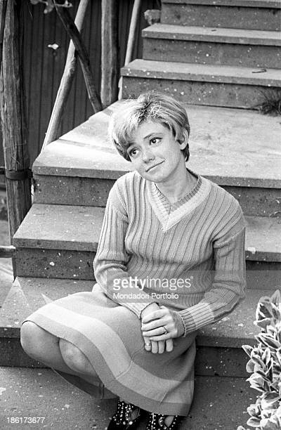 Italianborn Swiss singer and actress Rita Pavone sitting on a step 1968