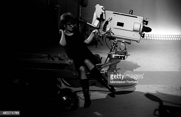 Italianborn Swiss singer and TV presenter Mina sitting beside a camera of the TV variety show Studio Uno at Teatro delle Vittorie Rome May 1966