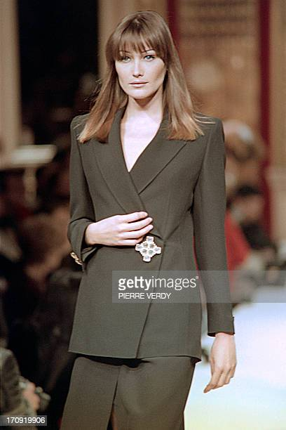 ItalianFrench fashion model Carla Bruni displays a creation by French designer Jean Louis Scherrer during the presentation of his readytowear...