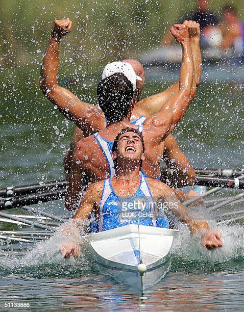 Italian's Alessandro Speranza celebrates with his team after winning the gold medal in the seniors men's coxed four final at the 'World Rowing...