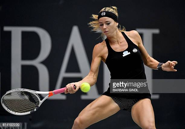 Italian's Camila Giorgi plays the ball during her match against US American's Madison Keys at the Generali Ladies Tennis Tournament in Linz on...