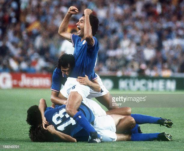 Italians defenders Antonio Cabrini and Claudio Gentile celebrate on top of their teammates after Italy defeated West Germany 31 in the World Cup...