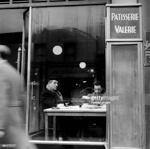 Italians eating and drinking in a cafe in Soho London 1955