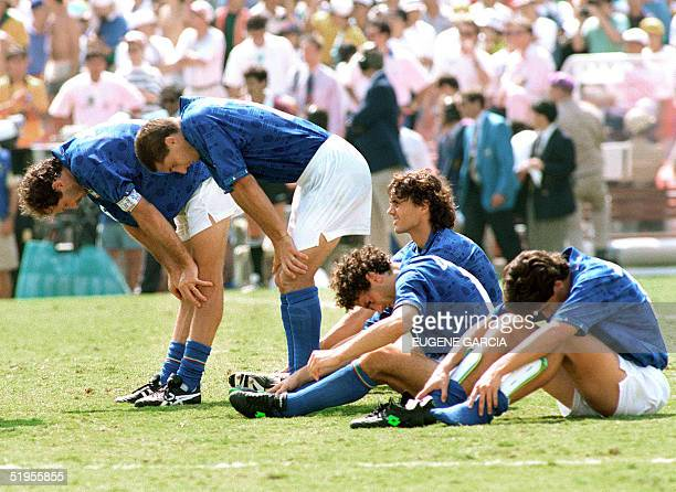 Italians Franco Baresi Daniele Massaro Paolo Maldini Roberto Donadoni and Demetrio Albertini show their disappointment 17 July 1994 at the Rose Bowl...