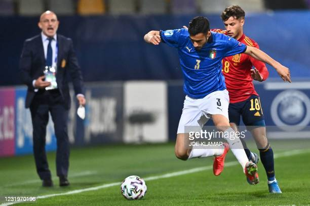 Italian's midfielder Gianluca Frabotta fights for the ball with Spain's forward Javier Puado during the 2021 UEFA European Under-21 Championship...