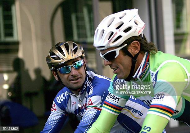 Italians Paolo Bettini and Mario Cipollini talk while riding at the start of the 96th MilanoSan Remo classic cycling race 18 March 2005 AFP PHOTO/...