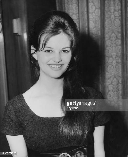 Italian-Tunisian actress Claudia Cardinale at a reception in London, 6th April 1959.