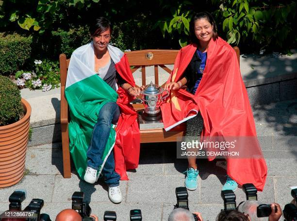 Italia's Francesca Schiavone and China's Li Na pose with the flag of their country during a photocall on the eve of their Women's final match in the...