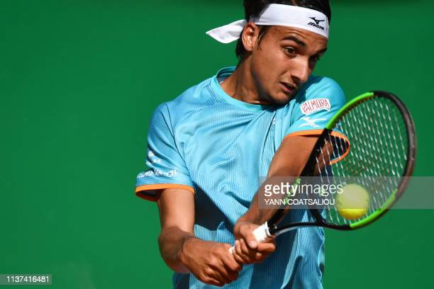 Italia's Lorenzo Sonego plays a backhand return to Italia's Andreas Seppi during their tennis match on the day 3 of the MonteCarlo ATP Masters Series...