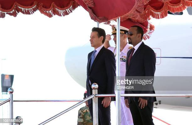 Italia's Prime Minister Giuseppe Conte stands next to his Ethiopian counterpart Abiy Ahmed during a welcome ceremony at the Bole international...