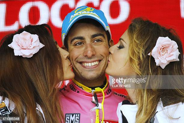 Italien Fabio Aru celebrates the pink jersey of overall leader on the podium of the 13th stage of the 98th Giro d'Italia, Tour of Italy, cycling race...