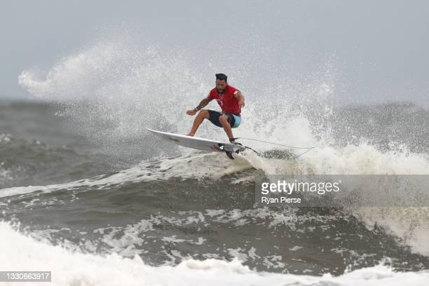 Italo Ferreira of Team Brazil surfs during the men's round 3 heat on day three of the Tokyo 2020 Olympic Games at Tsurigasaki Surfing Beach on July...