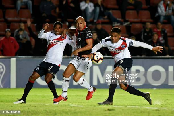 Italo Regalado of Peruvian Deportivo Municipal vies for the ball with Clemente Rodriguez of Argentinian Colon during a Copa Sudamericana 2019...