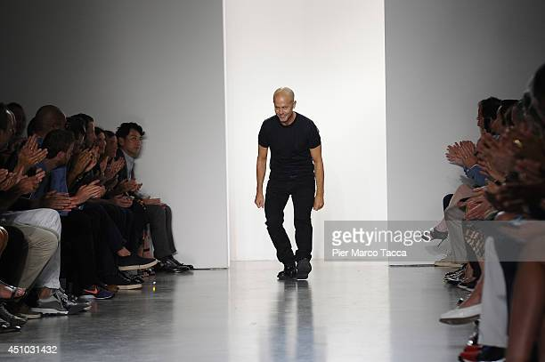 Italo Zucchelli acknowledges the applause of the audience after the Calvin Klein Collection show during Milan Fashion Week Menswear Spring/Summer...