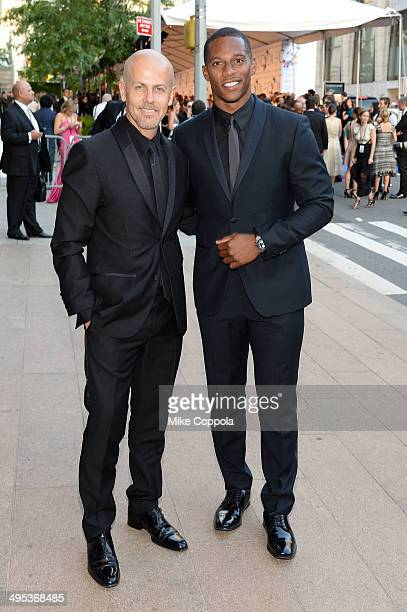 Italo Zucchelli and Victor Cruz attend the 2014 CFDA fashion awards at Alice Tully Hall Lincoln Center on June 2 2014 in New York City