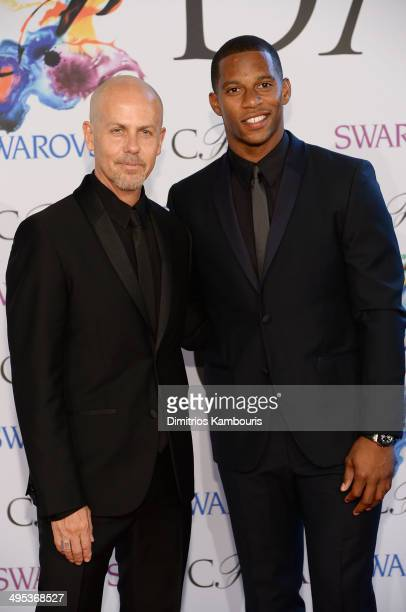 Italo Zucchelli and Victor Cruz attend the 2014 CFDA fashion awards at Alice Tully Hall, Lincoln Center on June 2, 2014 in New York City.