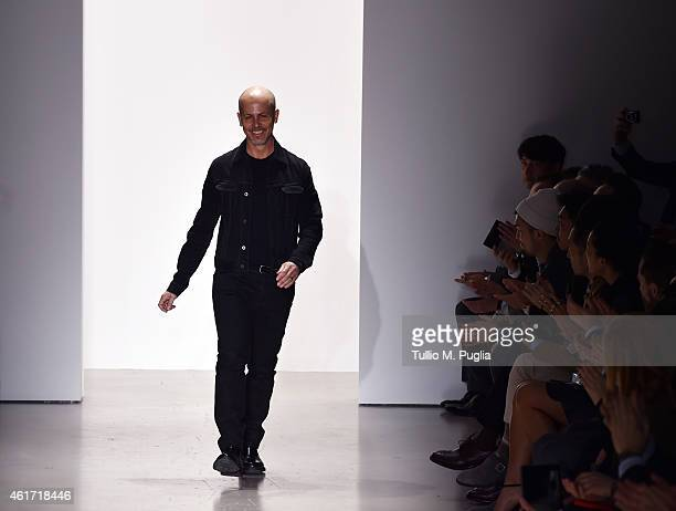 Italo Zucchelli walks the runway after the Calvin Klein Collection show as a part of Milan Menswear Fashion Week Fall Winter 2015/2016 on January 18...