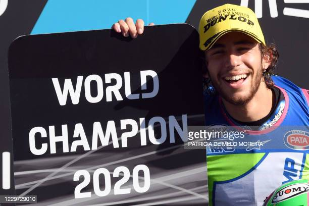 Italtrans Racing Team's Italian rider Enea Bastianini celebrates after becoming the new Moto2 world champion during the Portuguese Grand Prix at the...