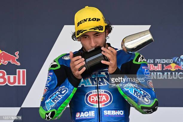 Italtrans Racing Team's Italian rider Enea Bastianini celebrates on the podium after winning the Moto2 race during the Andalucia Grand Prix at the...