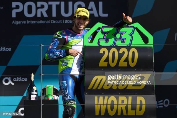 Italtrans Racing Team's Italian rider Enea Bastianini celebrates on the podium after becoming the new Moto2 world champion during the Portuguese...