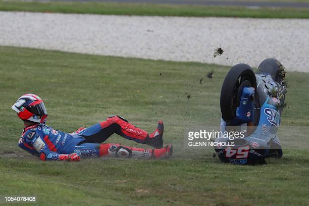 TOPSHOT Italtrans Racings Team Italian rider Mattia Pasini crashes while taking a turn during the Moto2 class gualifying session at Phillip Island on...