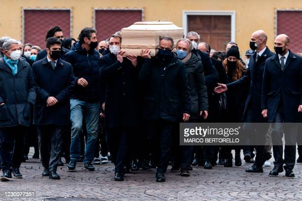Italy 1982 national footballteam players Marco Tardelli and Antonio Cabrini carry the coffin of late Italian football player Paolo Rossi in the Santa...