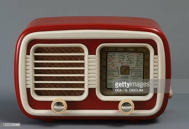 Italy, 20th century - Columbus red catalin radio, 1950's.