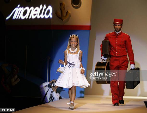 A girl displays fashion of the label Simonetta on 02 July 2005 during the Pitti Immagine Bimbo children fashion fair in Florence Italy Until 03 July...