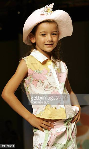 A girls displays fashion of the label BJ Explorer designed by Alviero Martini 01 July 2005 during the Pitti Immagine Bimbo children fashion fair in...