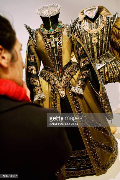 A visitor looks at the Piero Tosi's costumes weared in 'Don Carlo' by Italian director Mauro Bolognini during an exhibition of theatre and cinema...